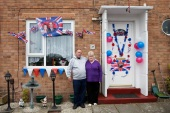 GB. England. Walsall. The Black Country. The Royal wedding between Kate Middleton and Prince William. Residents outside their home on Clare Road. 2011.