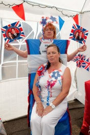GB. England. Walsall. The Black Country. The Royal wedding between Kate Middleton and Prince William. Jean Humpage (front) on Clare Road. 2011.